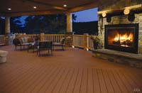Upgrading your deck with composite material and a fireplace
